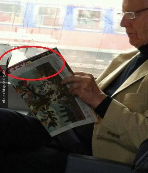 He is just reading a newspaper... NOT :D